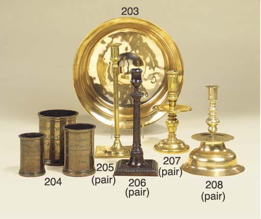 A pair of brass candlesticks