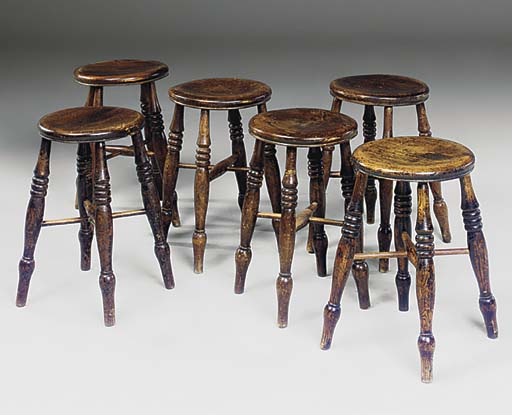 A SET OF SIX ENGLISH ELM STOOL