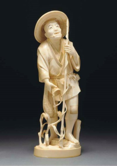 A Japanese ivory okimono of a