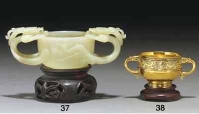 A Chinese celadon jade twin-ha