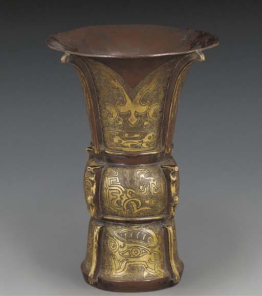 A gilt copper gu vase, 17th ce