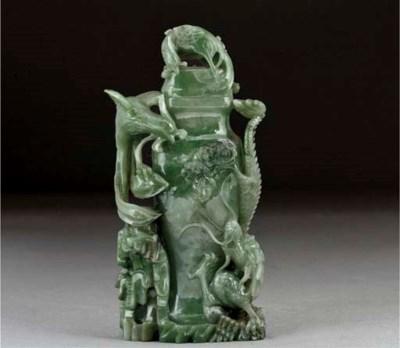 A spinach jadeite vase and cov