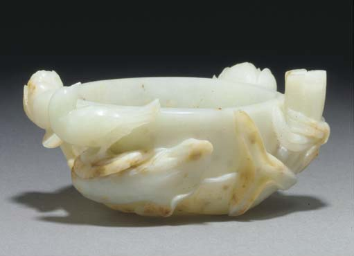 A Chinese pale celadon jade co