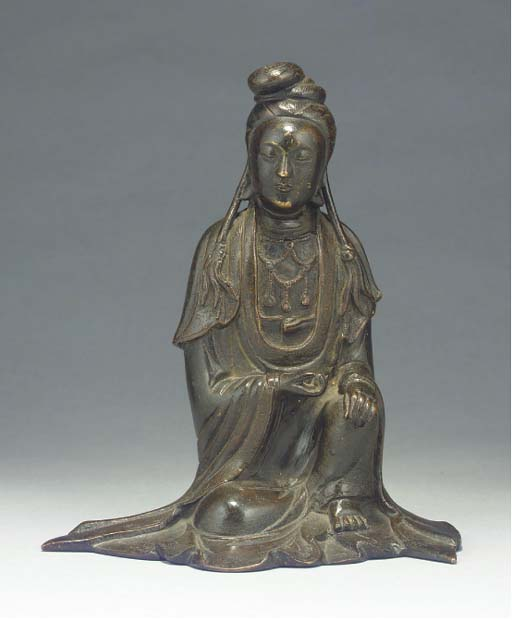 A Chinese bronze model of Guan