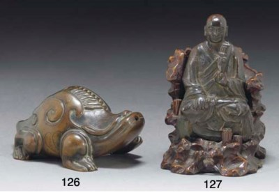 A Chinese bronze model of a lo
