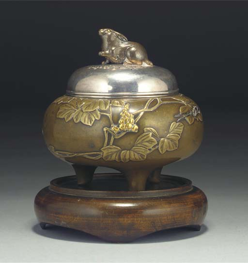 A Japanese bronze and inlaid tripod koro, silver cover and linner, 19th century
