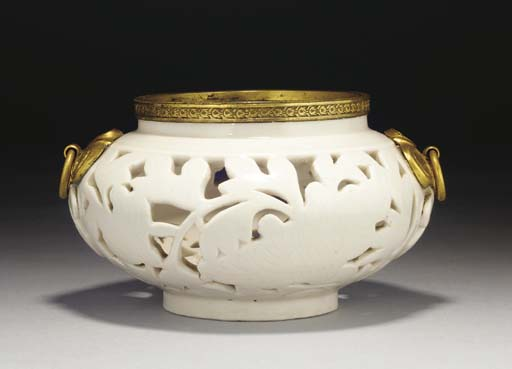 A Chinese blanc-de-chine gilt metal mounted pierced censer, the porcelain 17th century
