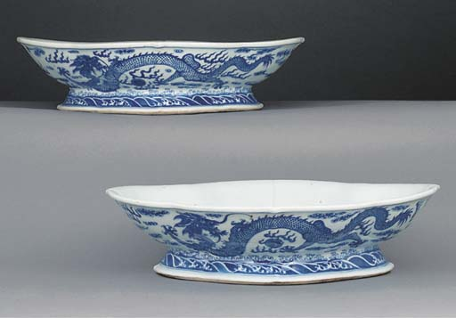 A pair of Chinese blue and white shaped footed dishes, 19th century