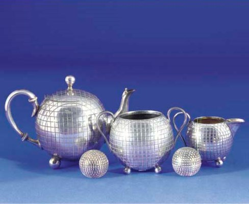 A WHITE-METAL THREE PIECE TEA