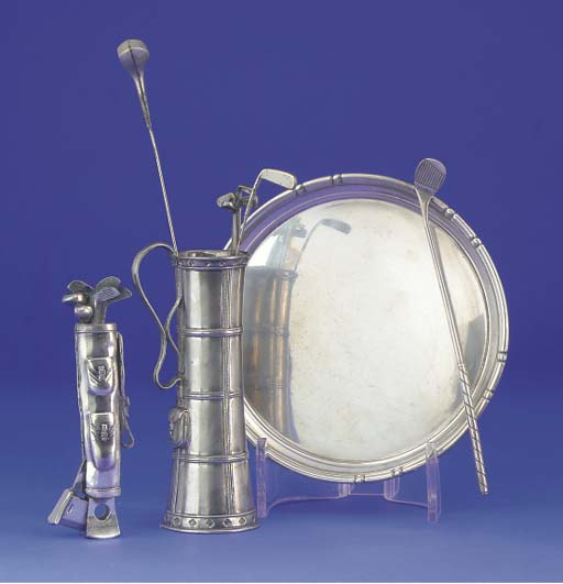 A WHITE-METAL HATPIN HOLDER