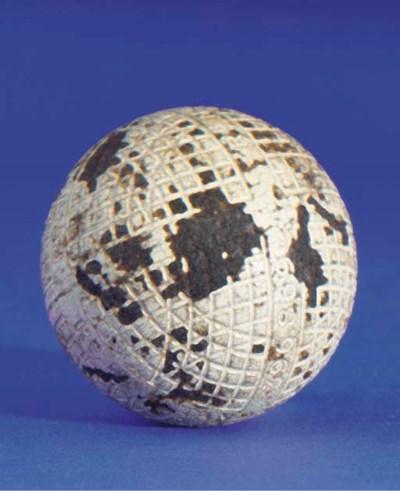 A MESH-PATTERN GUTTY GOLF BALL