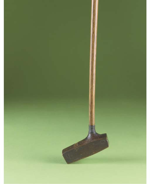 A CENTRE-SHAFTED TRAVIS PUTTER
