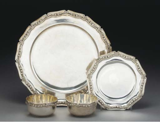 TWELVE METALWARE SIDE PLATES A