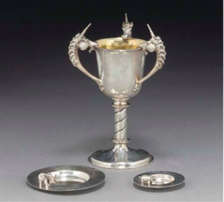 A MODERN SILVER GOBLET AND TWO