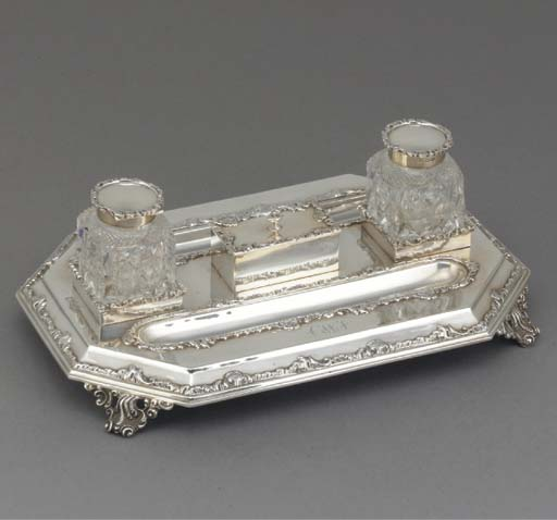 A LATE VICTORIAN SILVER TWO-BO