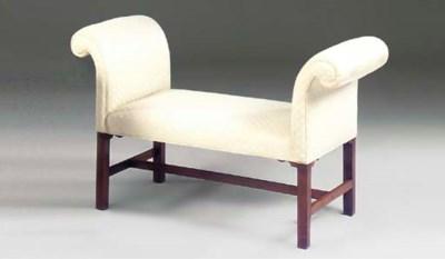 A mahogany and upholstered win