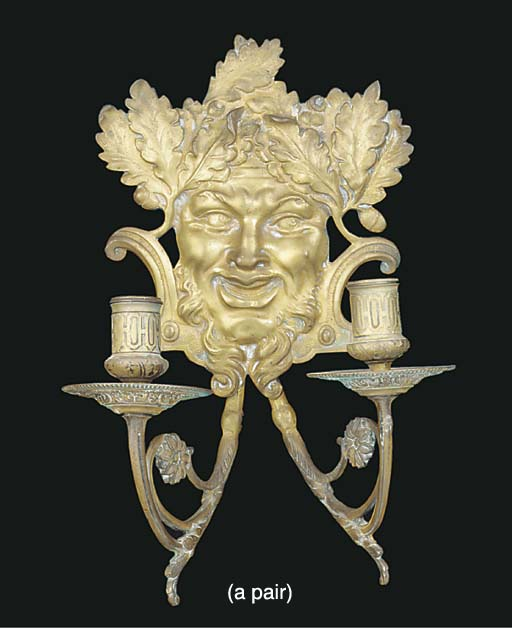 A pair of brass twin light wall appliques