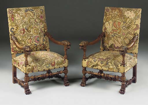 A PAIR OF CARVED WALNUT FAUTEUILS