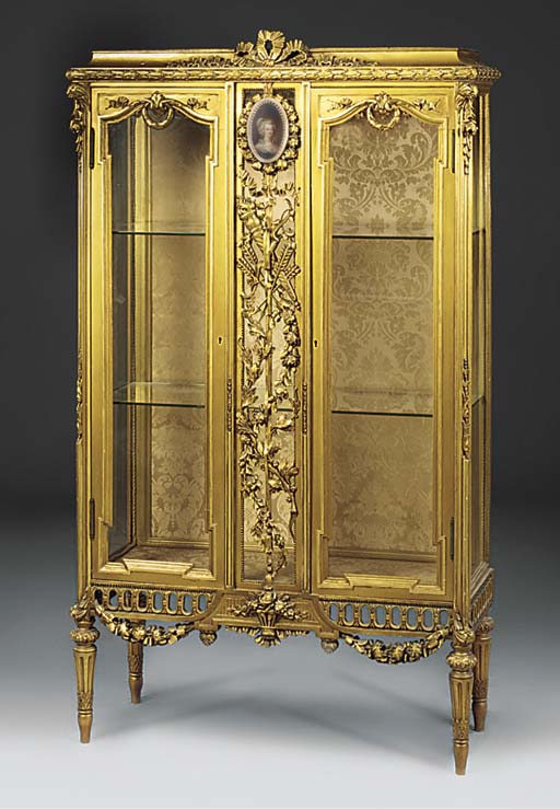 A GILT PAINTED VITRINE
