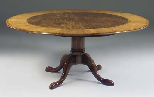 A mahogany and satinwood crossbanded breakfast table