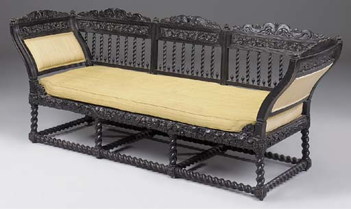 AN ANGLO-INDIAN EBONISED SETTEE