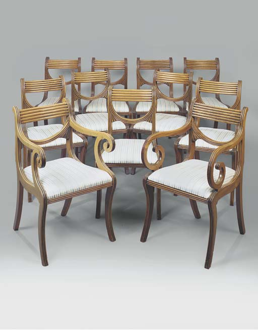 A SET OF ELEVEN REGENCY MAHOGANY DINING CHAIRS