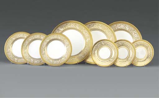 A Minton gold-ground 'Porcelain Ball' pattern part dinner-service