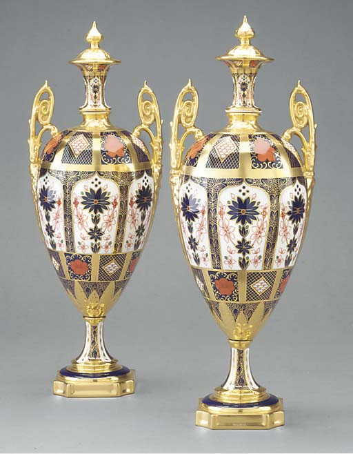 A pair of Royal Crown Derby two-handled oviform vases