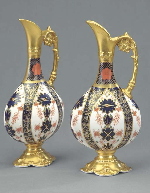 A pair of Royal Crown Derby Imari ewers