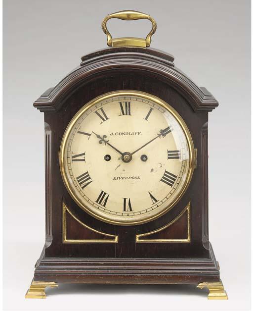 An English mahogany and brass-