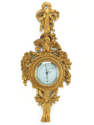 A French carved giltwood wheel