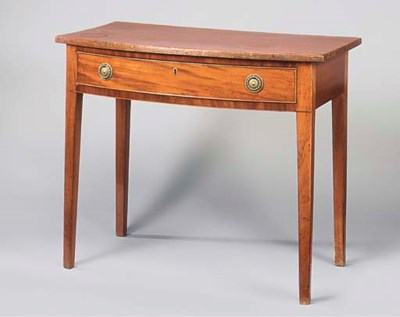 A MAHOGANY BOWFRONT SIDE TABLE
