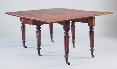 A MAHOGANY DROP-LEAF DINING TA