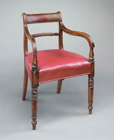 A REGENCY MAHOGANY AND RED LEA