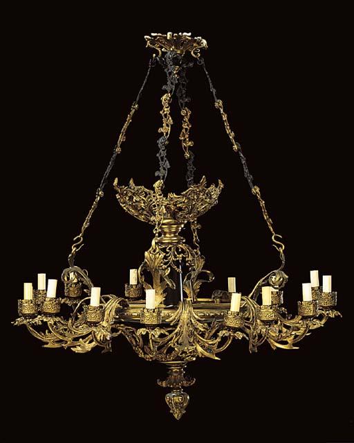 A gilt metal and bronze patina