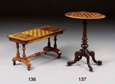 A VICTORIAN WALNUT GAMES TABLE
