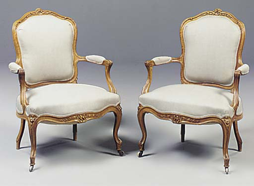 A PAIR OF FRENCH ELM FAUTEUILS