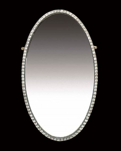 AN OVAL FACETED GLASS MIRROR