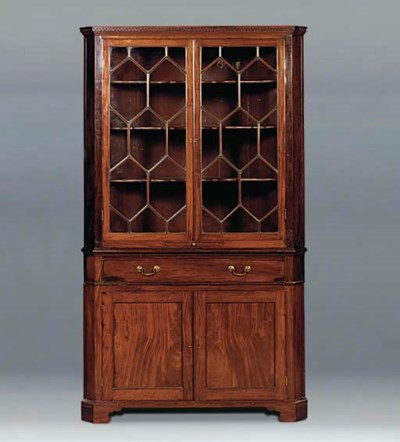 A mahogany corner cabinet