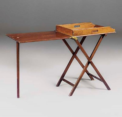 A mahogany butlers tray on sta