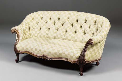 A VICTORIAN WALNUT SOFA