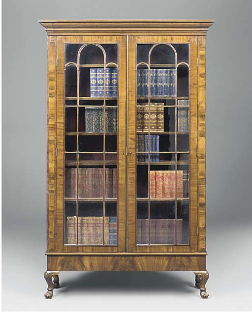 A MAHOGONY AND ROSEWOOD BOOKCA