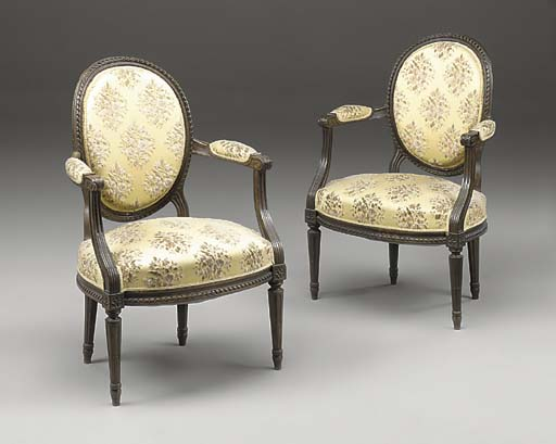 A PAIR OF FRENCH WALNUT FAUTEUILS