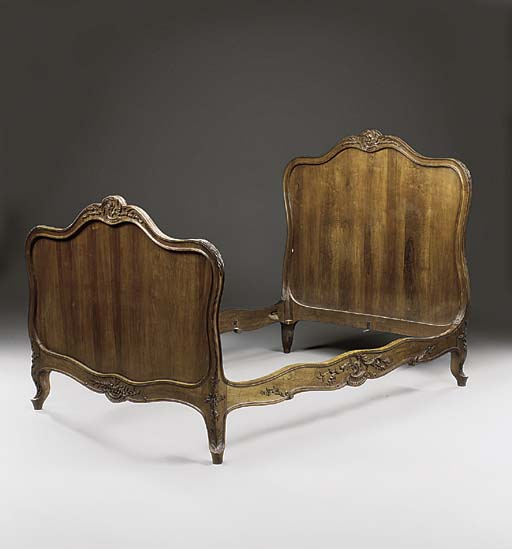 A FRENCH WALNUT BED