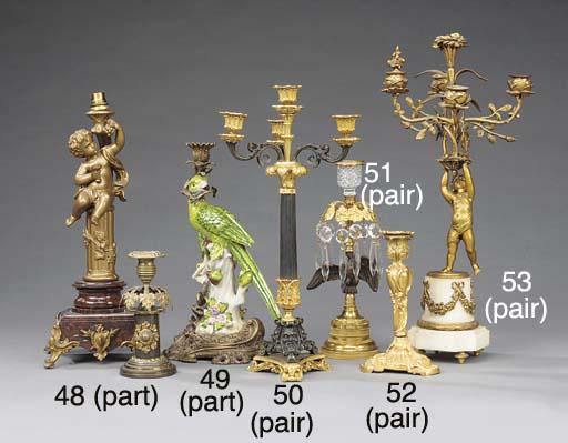 A pair of gilt bronze candlest