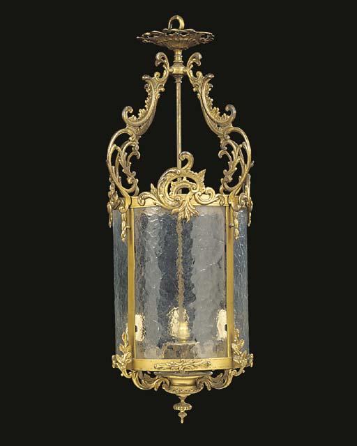 A gilt metal and opaque glass