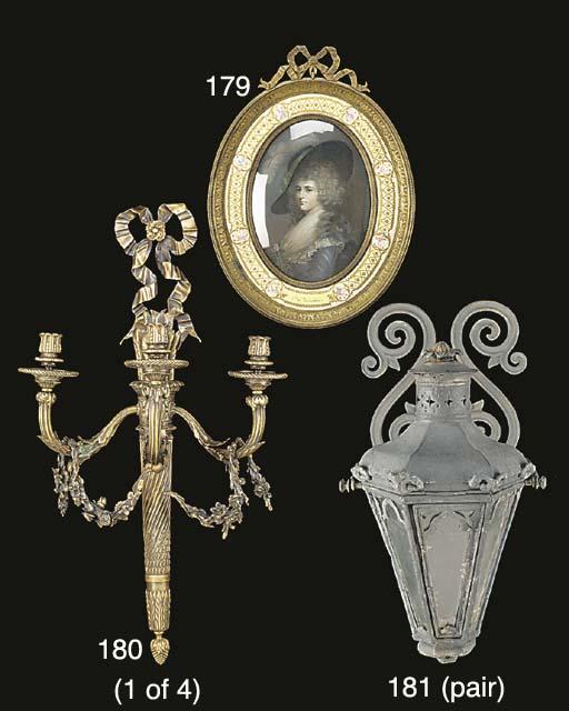 A gilt bronze and enamel frame