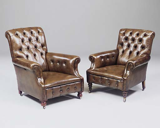 A NEAR PAIR OF LEATHER UPHOLST