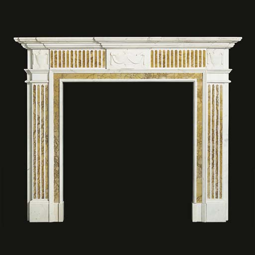 A carved white marble chimney