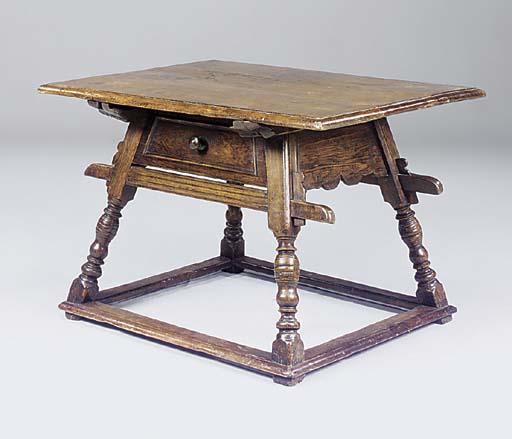 A GERMAN WALNUT AND OAK TABLE